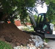 Crane digging in dirt mound in Salt Lake City