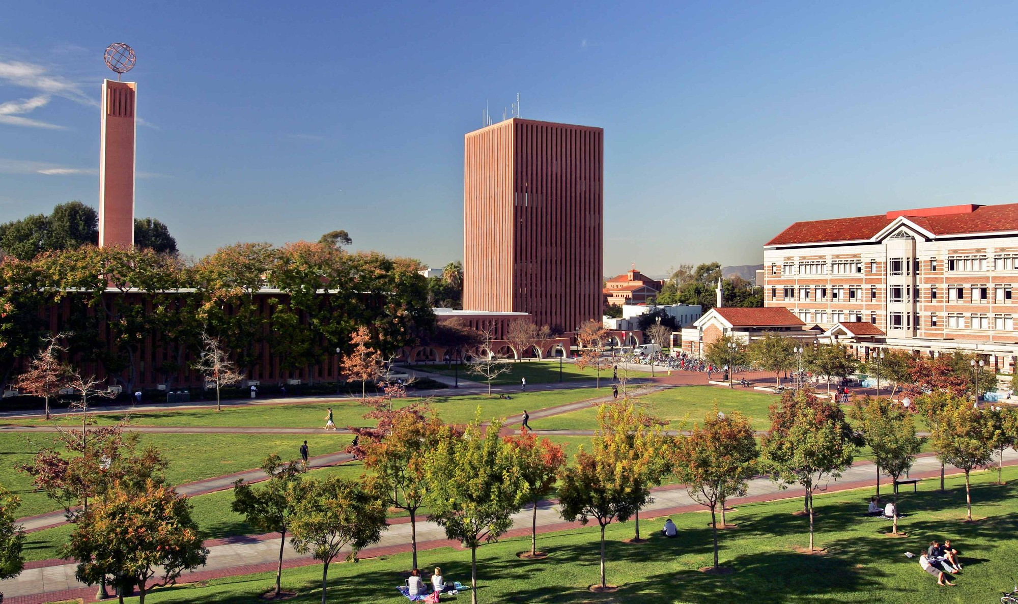 A view of USC's Rossier School of Education buildings with the grass quad in the foreground