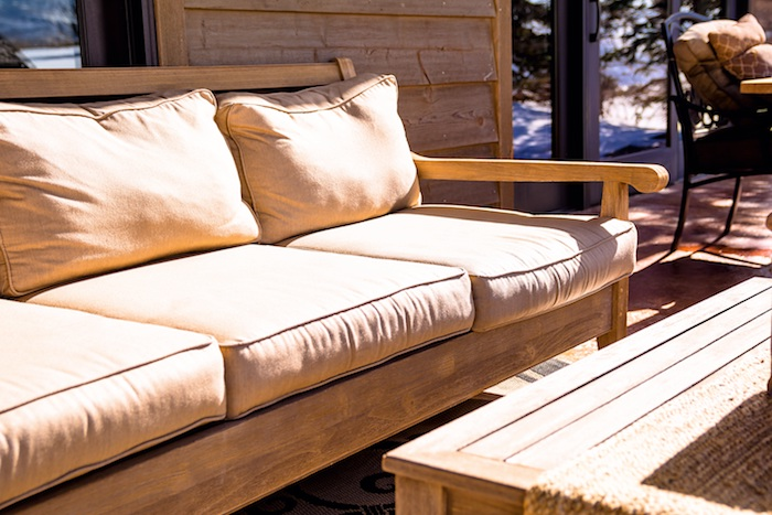 image of outdoor couch and end table