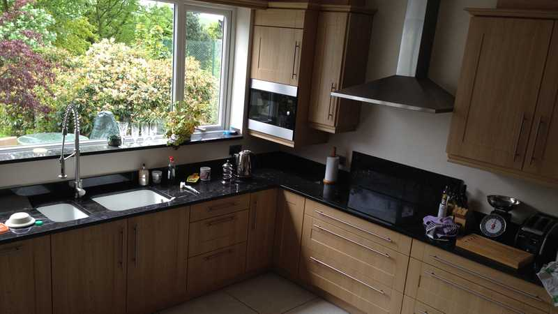 New kitchen fitted, including a double basing sink set in black granite worktops