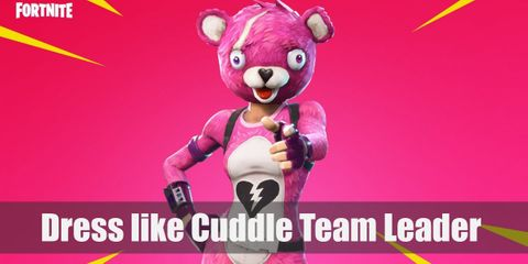 Cuddle Team Leader wears a pink fluffy tight skin suit, hot pink gloves, a pink armband, a black harness, a tactical belt, a thigh holster, a pink bear full-head mask, and pink boots with pink shoelaces.