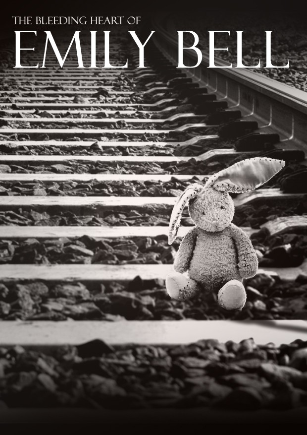 A rabbit teddy on the railway tracks
