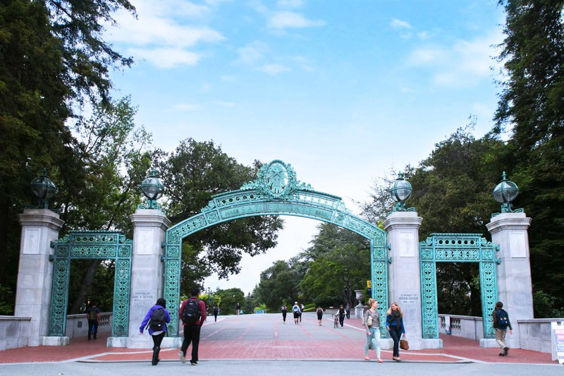 UC Berkeley students walking underneath the Sather Gate