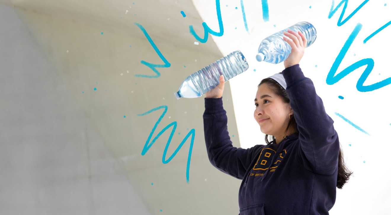 A person does an exercise workout by using water bottles as weights