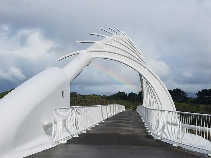 Mt Taranaki is shrouded in clouds but a rainbow centers the bridge instead