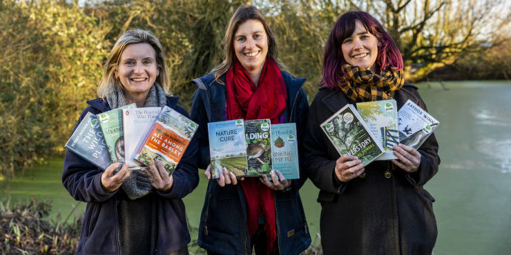 Sara Holman from Suffolk Wildlife Trust and Kellie Dimmock and Sophie Green from Suffolk Libraries holding the Wild Reads book collection