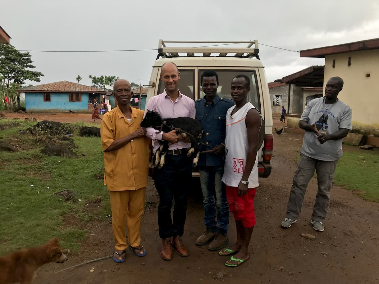 Nicolai Rottbøll receives a goat by the local chief as a thank you for the collaboration.