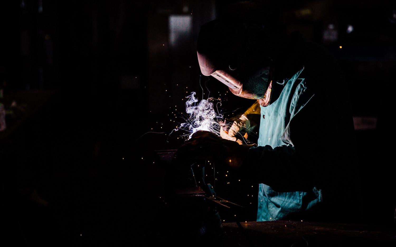 Pillar Innovations - Man welding.