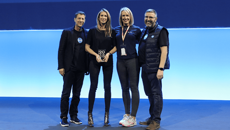 Futrli CEO, Hannah Dawson, COO, Helen Cockle, CEO of Xero, Steve Vamos and managing director, Gary Turner, stand on stage at Xerocon London 2018 as Futrli is awarded Practice App of the Year by Xero.