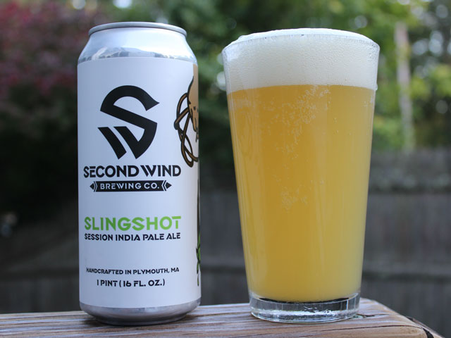 A 16oz can of Slingshot poured into a pint glass