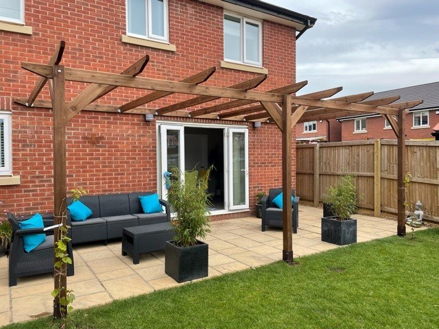 A module 2 pergola, constructed on a pateo built up against a brick house for a unique outdoor entertaining space.