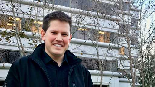 Armanino LLP Manager, Blake Oliver, smiles at camera wearing winter coat in front of building and trees to tell a day in the life and how to use futrli for business #entrepreneur
