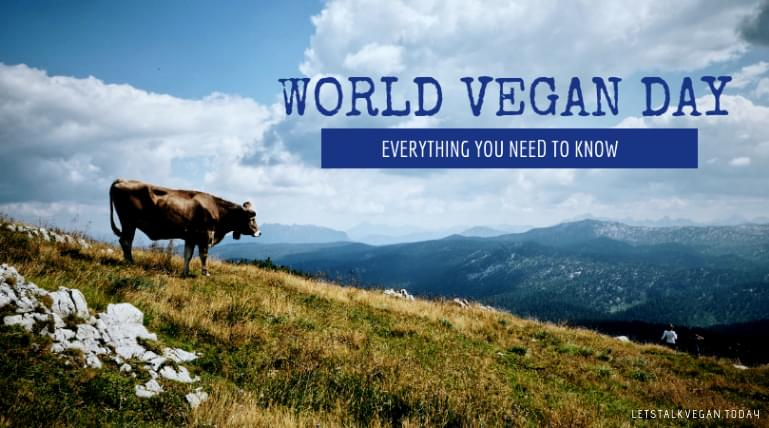 Picture of a cow on a hill with World Vegan Day writen across it