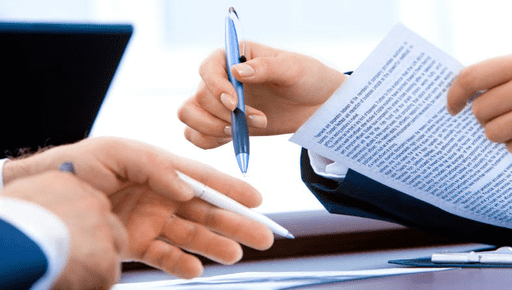 Accountant points at documents and paper with pen and discusses accountancy bookkeeping. #Accountancy