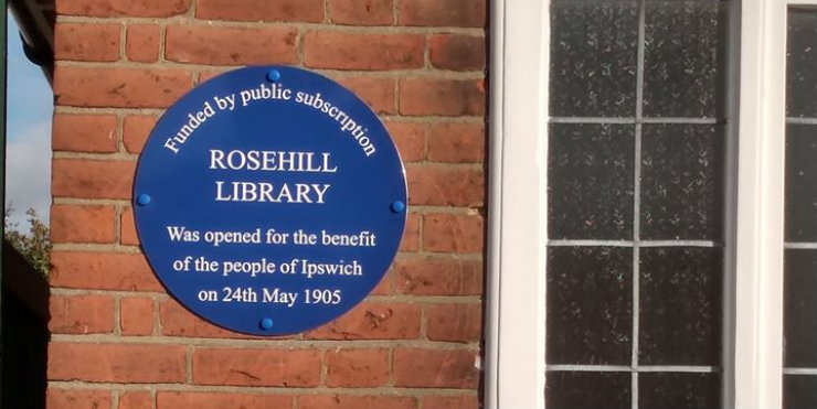 The blue plaque on the wall at Rosehill Library