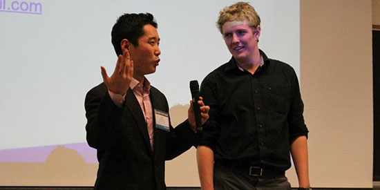 A photo of me pitching at the Queen's Startup Summit