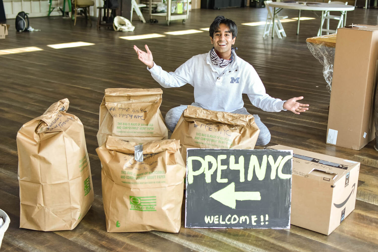 Our founder and CEO Krishna with bags of PPE