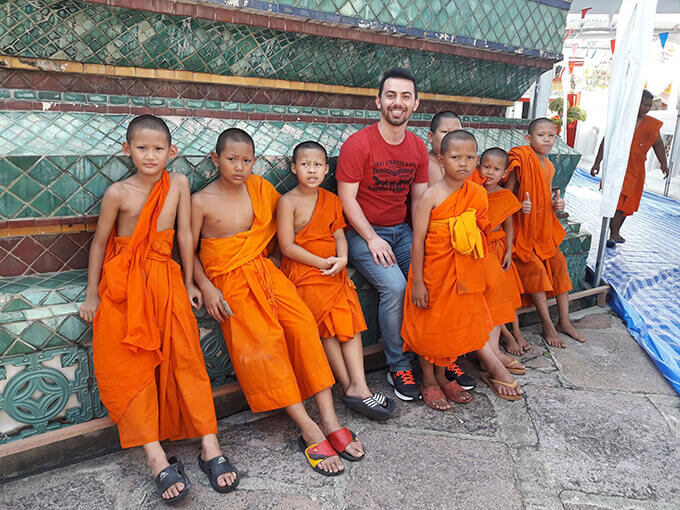 A photo of Yasin with little monks at Wat Pho, Thailand