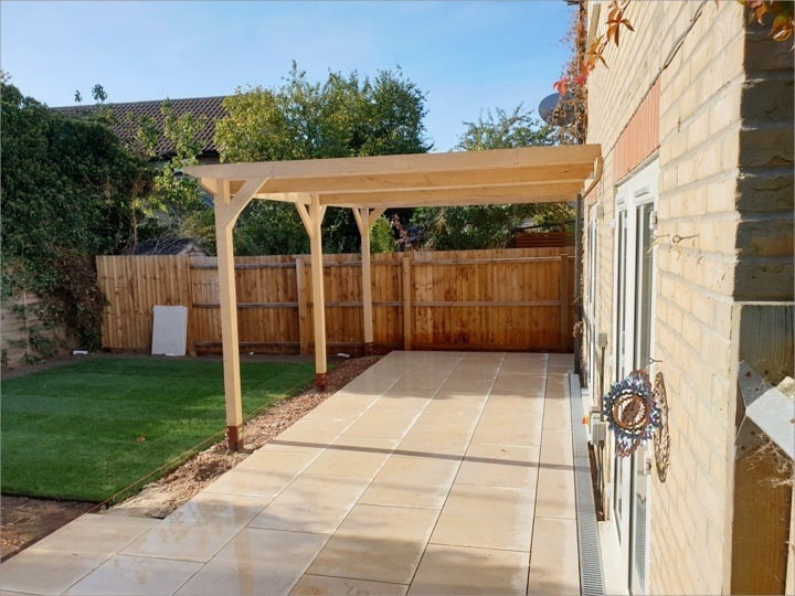 A freshly installed leon-to pergola over a customers patio