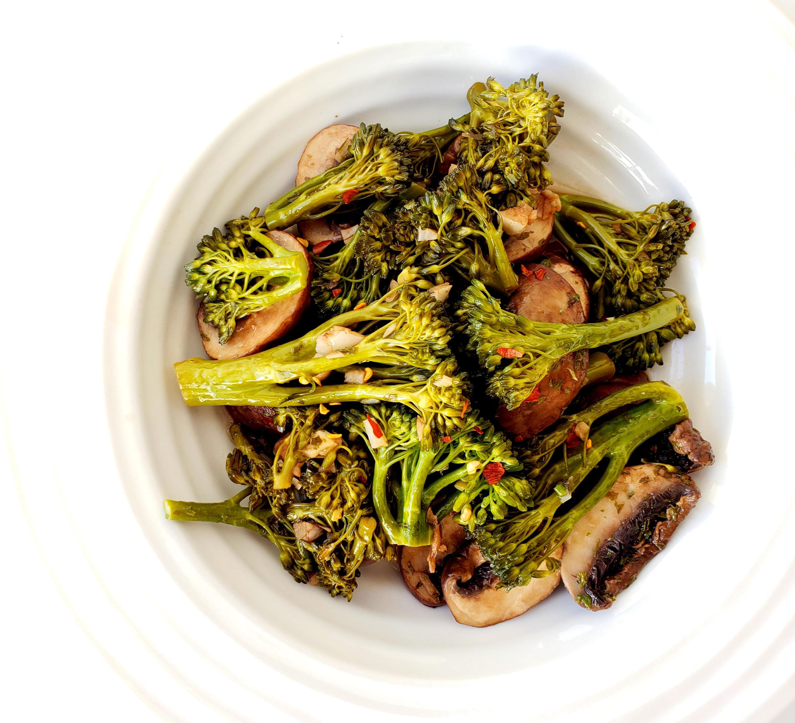 Bowl of balsamic broccolini and mushrooms with red pepper flakes