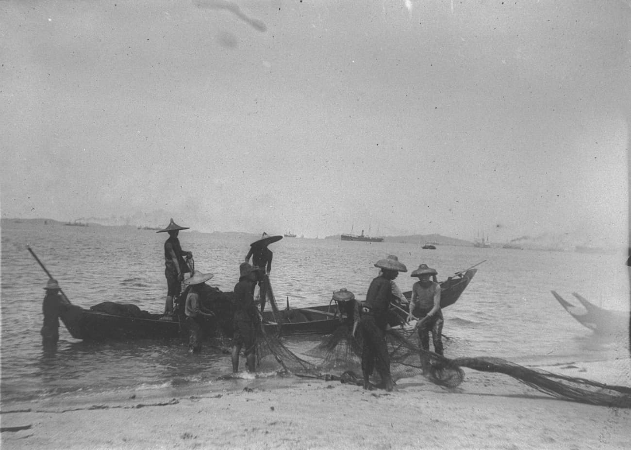 Fishermen at seashore, 1909