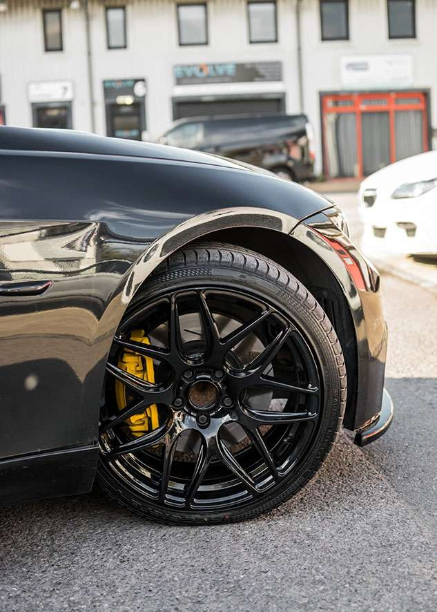 Black BMW 335i wheels after painting, wheel restoration and caliper sprayed yellow