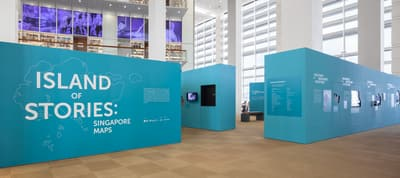 The entrance of the 'Island of Stories' exhibition, formed by blue walls.