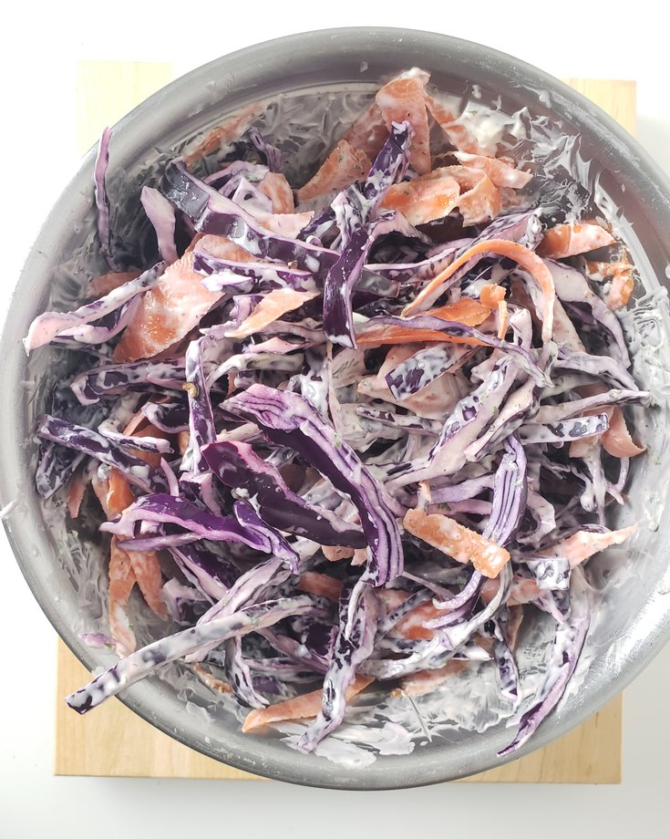 Bowl of red cabbage and carrot cole slaw