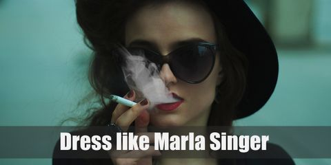 She's not your typical leading lady, that's for sure! Marla's brutal honesty is both refreshing and endearing. Marla's style is as disheveled as she looks but definitely iconic in its own right. This all black ensemble is as eccentric and wonderful as its wearer.
