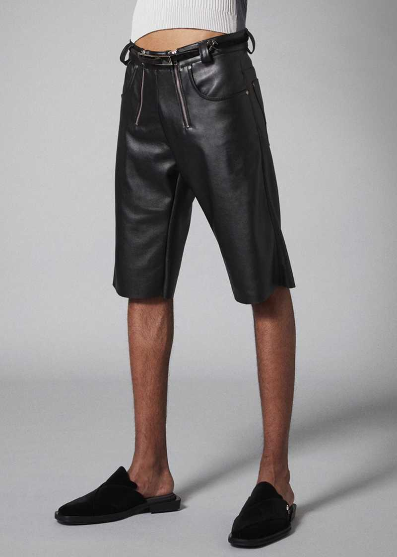AMIR shorts in black vegan leather. GmbH Spring/Summer 2021 'RITUALS OF RESISTANCE'