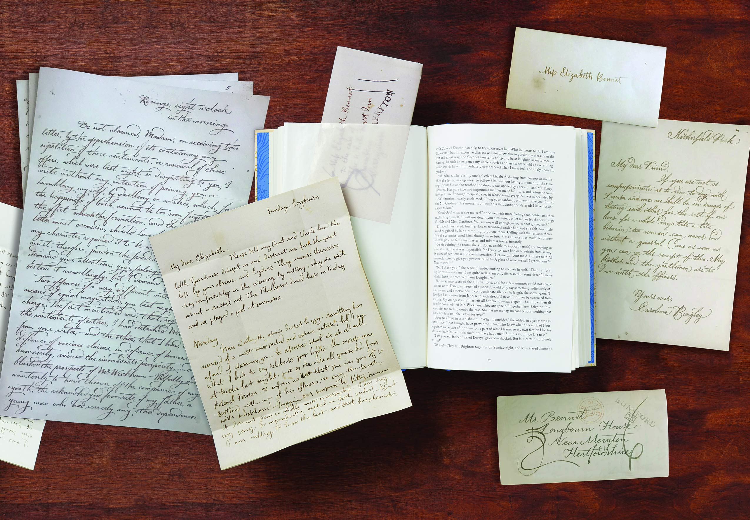 handwritten letters on a wooden table