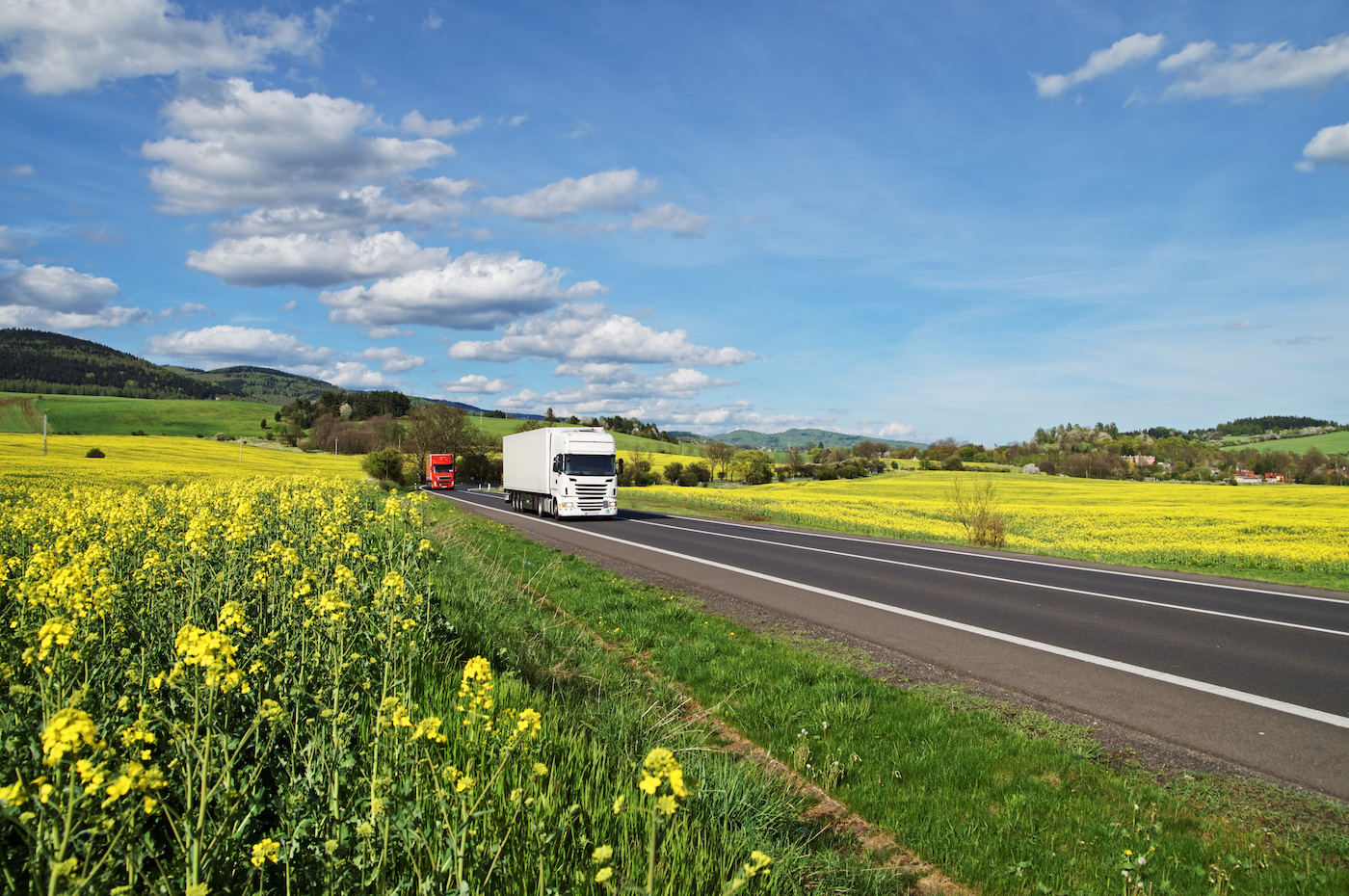 truck-driving-past-field