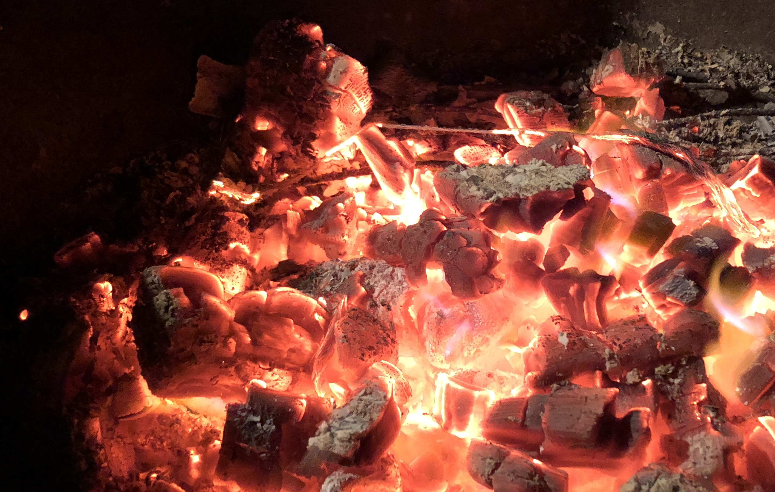 Hot coals produced from compressed charcoal apple smoking log