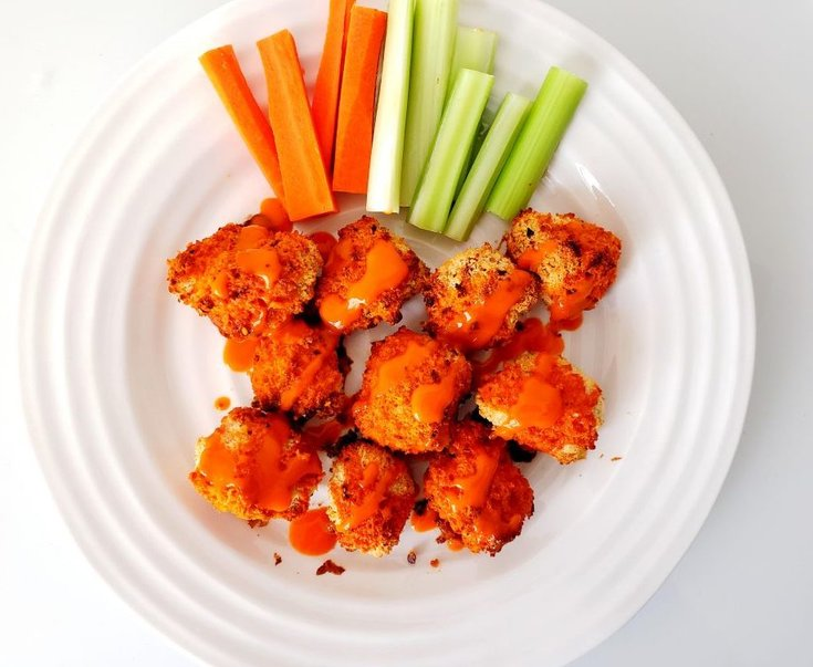 Plate of Cauliflower Wings Drizzled with Buffalo Sauce