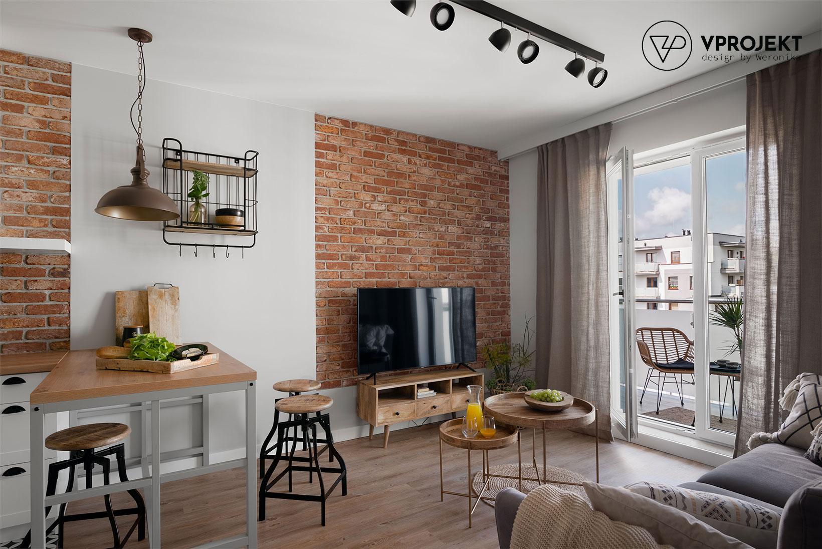 Salon z aneksem kuchennym, w tle wyjście na balkon