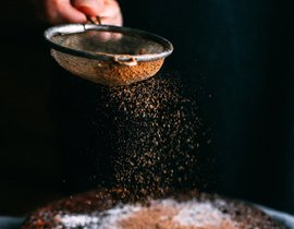 sifting cinnamon sugar