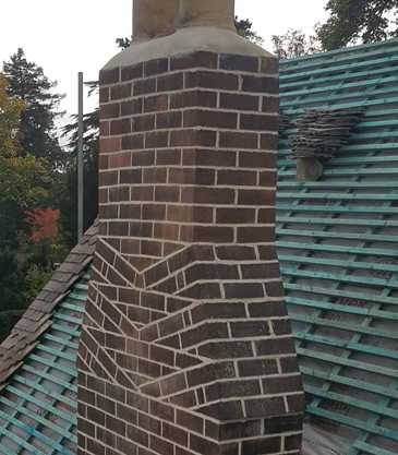 Repairs to a weathered chimney and a pitched roof which has had both its felt and batten replaced