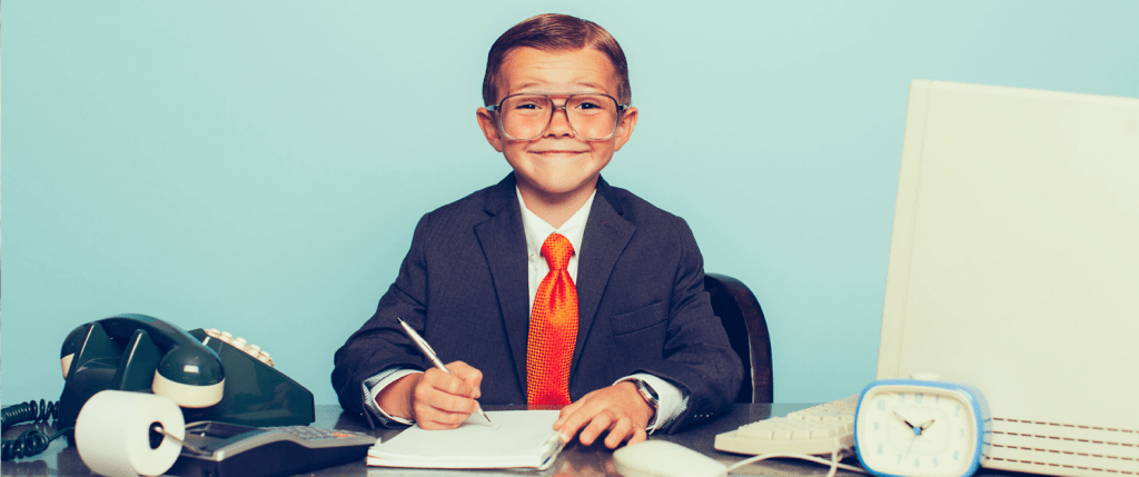 A small boy playing accountant