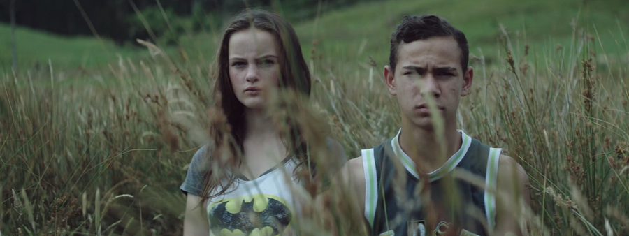 10 Feet Tall campaign still of boy and girl in field