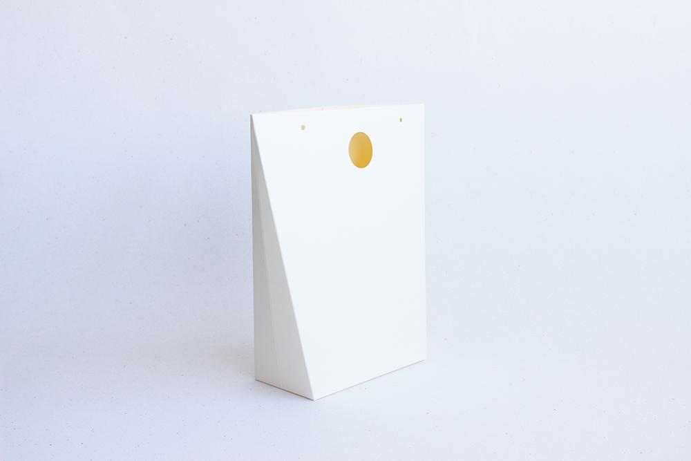 Skládací dárková taška v krémové barvě
