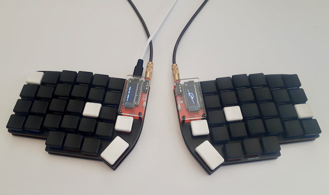 The Lily58 pro, with blank keycaps.