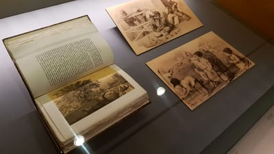 A close-up of a journal and various sepia sketches of everyday street life in early Singapore.