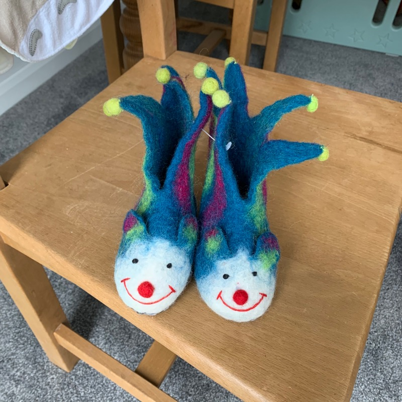 A nightmarish pair of felt jester shoes for a baby.