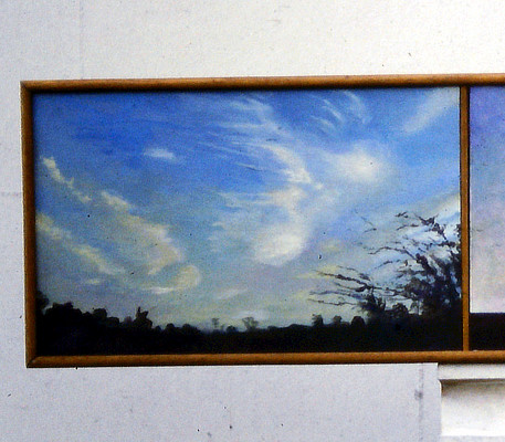 triptych painting of skies with horizon just visible