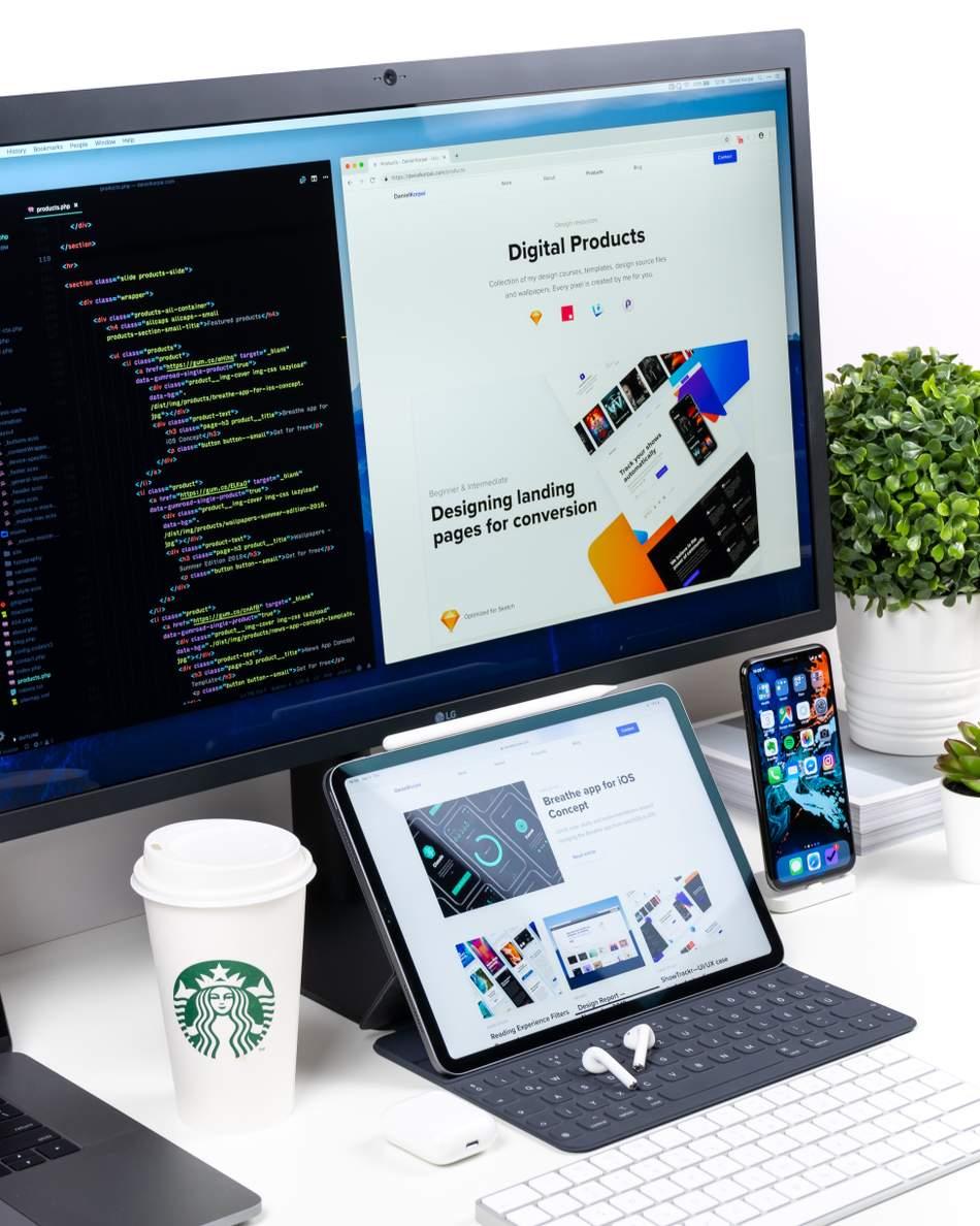An Image depicting a web developers desk set up.