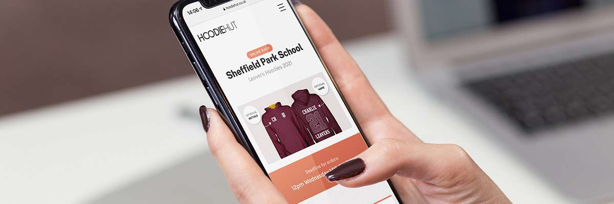 A student on iPhone ordering hoodies using our online shop