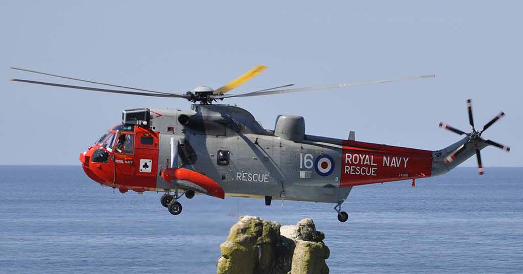 Royal Navy helicopter hovering above land