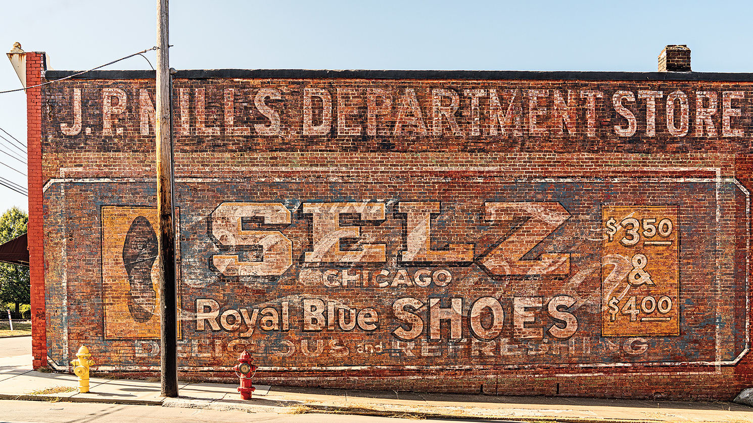 vintage sign painted on a red brick wall