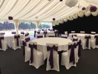 Wedding outdoor dining area pavillion with black and white decor