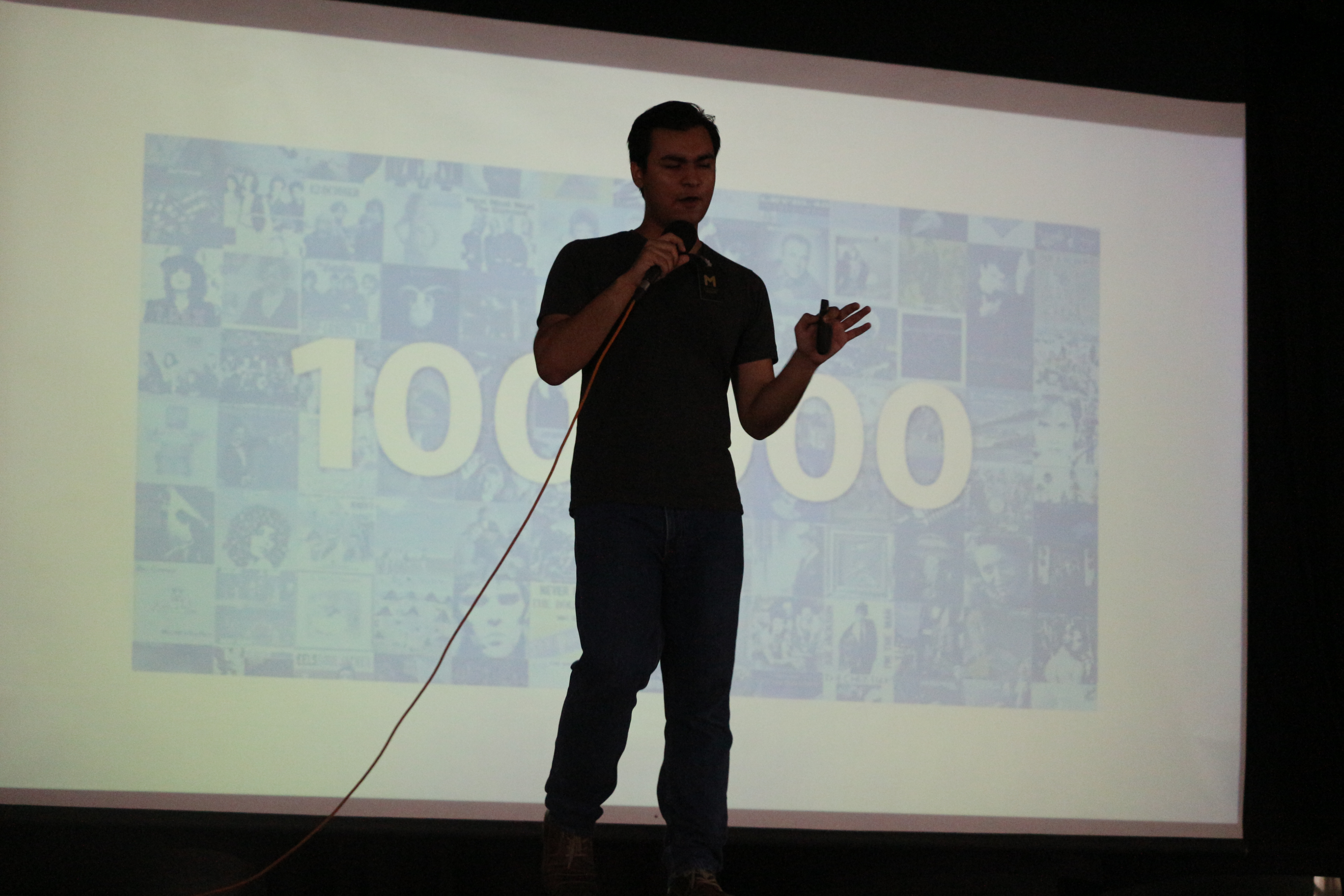 Anand Chowdhary speaking on stage
